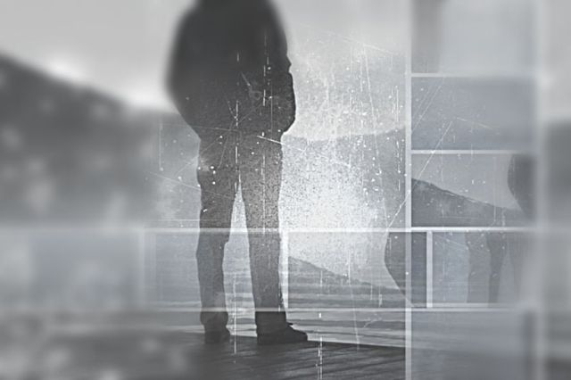 depressed person standing on dock by lake